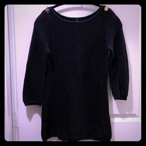 Ribbed black sweater with gold accent buttons